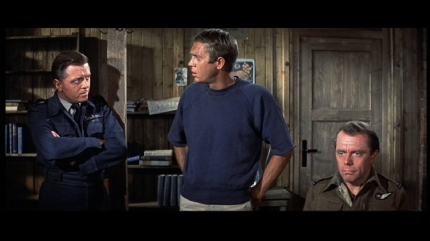 The Cooler King (Steve McQueen) offers his latest excuses for trying to escape in THE GREAT ESCAPE, courtesy Fox Home Video, 2013
