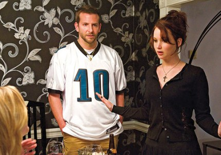 Pat (Bradley Cooper) and Tiffany (Jennifer Lawrence) in an awkward moment at a friend's dinner, in SILVER LININGS PLAYBOOK, courtesy Alliance, 2013
