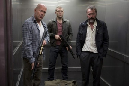 The boys ride an elevator to danger in A GOOD DAY TO DIE HARD, courtesy Fox Home Video, 2013