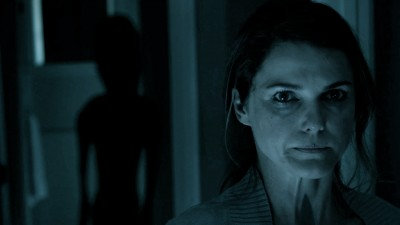 Lacy (Keri Russell) unaware of a presence behind her in DARK SKIES, courtesy eOne, 2013