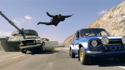 Roman (Tyrese Gibson) jumps to safety in a key scene from FAST AND FURIOUS 6, courtesy Universal, 2013